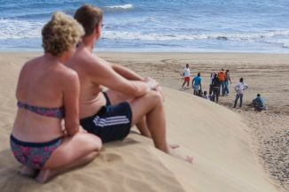 "STUPID ILLEGAL IMMIGRANTS SEEKING ""BETTER LIFE"" ABROAD GIVEN NOW-FAMILIAR ""EBOLA VIRUS"" TREATMENT ON NUDIST BEACH...SEE PICS ESPECIALLY THE DUMP TRUCK!"