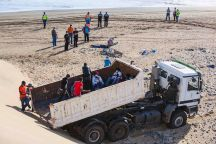 """STUPID ILLEGAL IMMIGRANTS SEEKING """"BETTER LIFE"""" ABROAD GIVEN NOW-FAMILIAR """"EBOLA VIRUS"""" TREATMENT ON NUDIST BEACH...SEE PICS ESPECIALLY THE DUMP TRUCK!"""